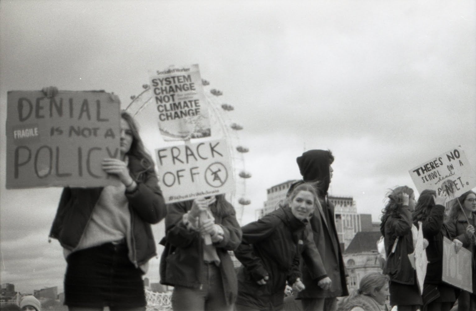 people standing holding signs during a protest in london