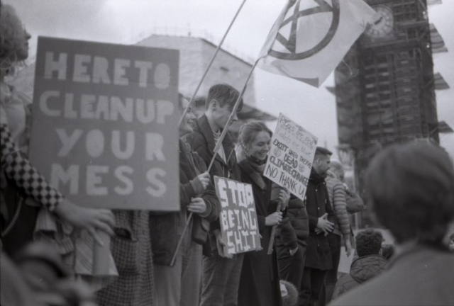 signs held by protestors outside big ben