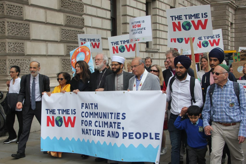 a photo of dr rowan williams and the multi faith climate lobby