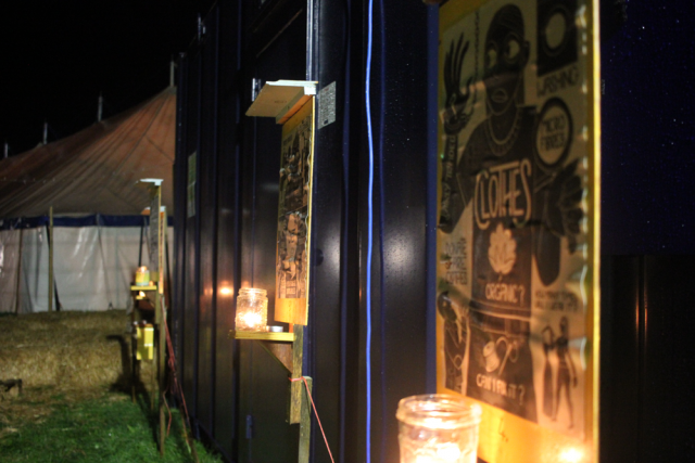 A photo of posters by candlelight